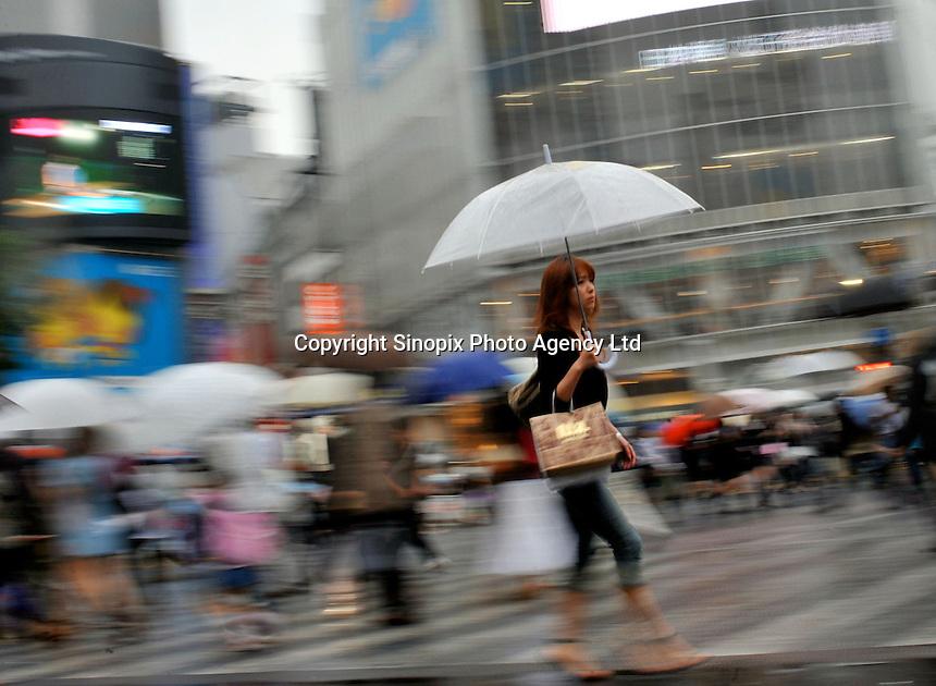 People cross Shibuya in Central Tokyo, Japan..05 Jun 2009