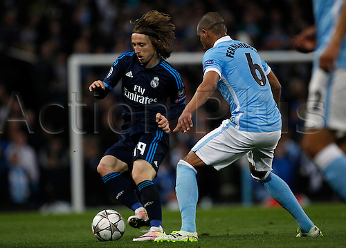 26.04.2016. The Etihad, Manchester, England. UEFA Champions League. Manchester City versus Real Madrid. Real Madrid midfielder Luka Modric takes on Manchester City midfielder Fernando.
