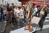 Moscow, Russia, 19/05/2012..Several thousand artists and opposition activists demonstrate against Vladimir Putin by walking through Moscow transporting their artworks. The protest coincided with Museum Night, when Moscow's museums are open until midnight with special exhibitions and performances.