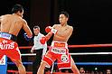 (L-R) Terdsak Kokietgym (THA), Takahiro Aou (JPN),.APRIL 6, 2012 - Boxing :.Terdsak Kokietgym of Thailand in action against Takahiro Aou of Japan during the WBC super featherweight title bout at Tokyo International Forum in Tokyo, Japan. (Photo by Mikio Nakai/AFLO)