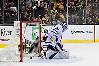 April 25, 2018: Boston Bruins left wing Jake DeBrusk (74) slides by the net after scoring a goal against Toronto Maple Leafs goaltender Frederik Andersen (31) during game seven of the first round of the National Hockey League's Eastern Conference Stanley Cup playoffs between the Toronto Maple Leafs and the Boston Bruins held at TD Garden, in Boston, Mass. Boston defeats Toronto 7-4 and wins the best of seven series 4 games to 3 to advance to round two.