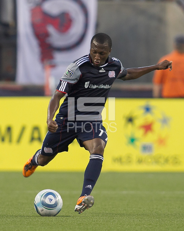 New England Revolution midfielder Sainey Nyassi (17) passes the ball. In a Major League Soccer (MLS) match, the New England Revolution tied the Chicago Fire, 1-1, at Gillette Stadium on June 18, 2011.