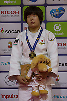 Gold medalist Mami Umeki of Japan celebrates her victory during an awards ceremony after the Women -78 kg category at the Judo Grand Prix Budapest 2018 international judo tournament held in Budapest, Hungary on Aug. 12, 2018. ATTILA VOLGYI