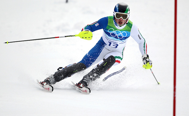 Italy's Giuliano Razzoli passes a gate in the men's slalom at the XXI Olympic Winter Games Saturday, February 27, 2010 in Whistler, British Columbia.