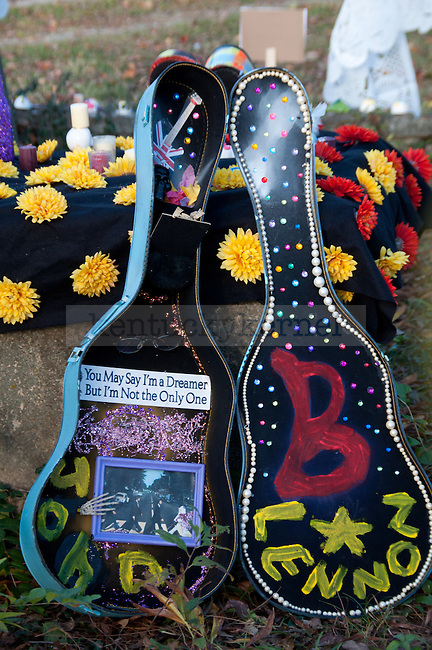 A guitar case filled with pictures and flowers decorates a gravestone at the Day of the Dead Ceremony in Downtown Lexington, Ky., on Thursday, November 1, 2012..