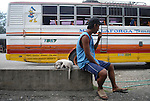 A Filipino man and his dog waits at a bus stop in Ilocos Norte, Philippines..**For more information contact Kevin German at kevin@kevingerman.com