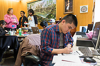 Anh Bui (right), 19, works on homework during a Lunar New Year celebration at Middlesex Community College's Asian American Connections Center on Thus., Feb. 15, 2018. The Asian American Connections Center was established at the school using a federal grant in 2016 and serves as a focal point for the Asian community at the school, predominantly Cambodian, to gather, socialize, study, and otherwise take part in student life. Bui is of Vietnamese heritage and is a Physical Science student at MCC.
