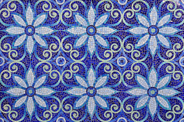 Natasha, a hand cut jewel glass mosaic is shown in Iolite, Lapis Lazuli, Blue Spinel, Covellite, and Feldspar, is part of the Textiles Collection by New Ravenna.