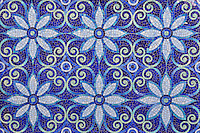 Natasha, a hand cut jewel glass mosaic is shown in Iolite, Lapis Lazuli, Blue Spinel, Covellite, and Feldspar, is part of the Delft Collection by Sara Baldwin for New Ravenna Mosaics.