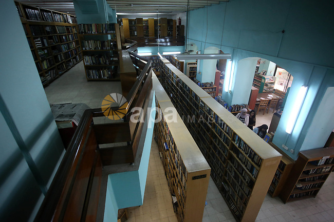 Palestinian researchers select books at Nablus public library in the West Bank city of Nablus, on August 6, 2017. Nablus public library, the largest, and the oldest, in all of Palestine, opened in 1960, and library includes approximately 80,000 books, the majority of which are in Arabic. Besides the circulating collection, Nablus Library also houses several significant archival collections, including the so-called Prisoner's Section, an archive of materials made and used by Palestinian prisoners held in Israeli jails between 1975 and 1995, as well as the personal collection of Qadri Tuqan, a Nablusi educator and one of the founders of An-Najah College, now An-Najah National University.Other collections include Palestinian newspapers dating back to the 1920s. Photo by Ayman Ameen