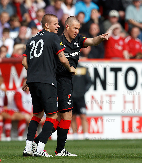 Kenny Miller turns to the Rangers fans after firing in goal no 2