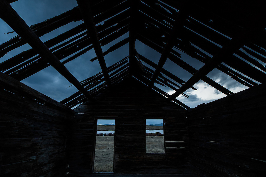 From a single exposure, the clouds are seen through the broken roof of this derelic old cabin near the Anaconda area of Montana.