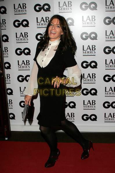 CLAUDIA WINKLEMAN.Attending the 10th Anniversary GQ Men Of The Year Awards, Royal Opera House, Covent Garden, London, England..September 4th 2007.full length black and white cream rib shirt dress sixties style tights hand on hip.CAP/AH.©Adam Houghton/Capital Pictures