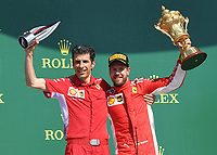 Claudio Albertini of Scuderia Ferrari and SEBASTIAN VETTEL (GER) of Scuderia Ferrari on the podium during The Formula 1 2018 Rolex British Grand Prix at Silverstone Circuit, Northampton, England on 8 July 2018. Photo by Vince  Mignott.