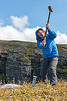 Dave Macleod driving ground belay stakes at the top of Longhope Route Direct.