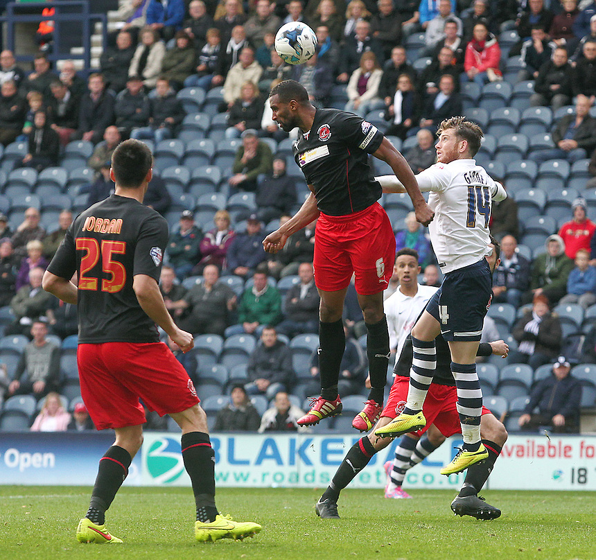 Fleetwood Town's Nathan Pond wins an aerial ball under pressure from Preston North End's Joe Garner<br /> <br /> Photographer Rich Linley/CameraSport<br /> <br /> Football - The Football League Sky Bet League One - Preston North End v Fleetwood Town - Saturday 25th October 2014 - Deepdale - Preston<br /> <br /> &copy; CameraSport - 43 Linden Ave. Countesthorpe. Leicester. England. LE8 5PG - Tel: +44 (0) 116 277 4147 - admin@camerasport.com - www.camerasport.com