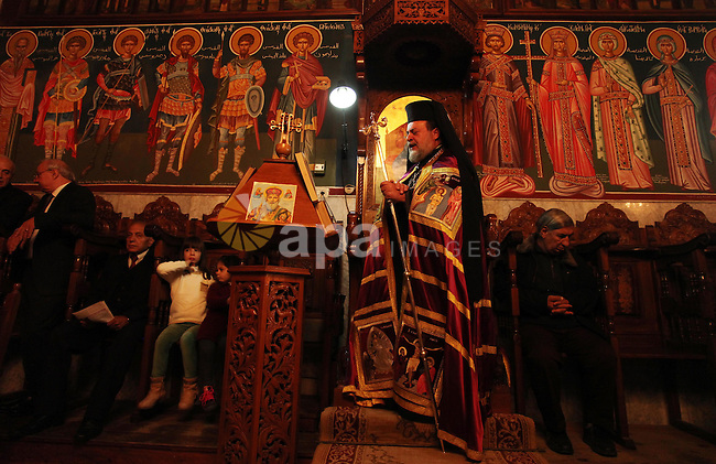 Palestinian Orthodox Christian altar boys attend a Christmas mass at the Saint Porphyrios Greek Orthodox church in Gaza City on January 7, 2017. According to the Gregorian calendar, Orthodox Christmas falls 13 days after the December 25 Western feast celebrated in line with the Julian calendar. Photo by Ashraf Amra