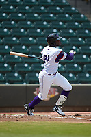 Luis Robert (21) of the Winston-Salem Rayados follows through on his swing against the Potomac Nationals at BB&T Ballpark on August 12, 2018 in Winston-Salem, North Carolina. The Rayados defeated the Nationals 6-3. (Brian Westerholt/Four Seam Images)