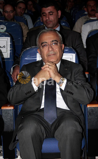Palestinian prime minister Salam Fayyad attends the opening ceremony during the inauguration of Yasser Arafat Building at Hebron University in the Palestinian city of Hebron in the West Bank on May 30, 2011.Photo by Najeh Hashlamoun