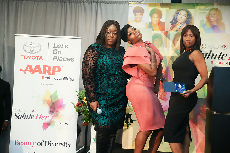 Hosts Loni Love and Angelique Perrin poses with Soul Solidarity Award Honoree Fantasia Barrino-Tyalor is seen backstage, with a cute baby Coby at the Salute Her Awards sponsored by Toyota and AARP in Charlotte.