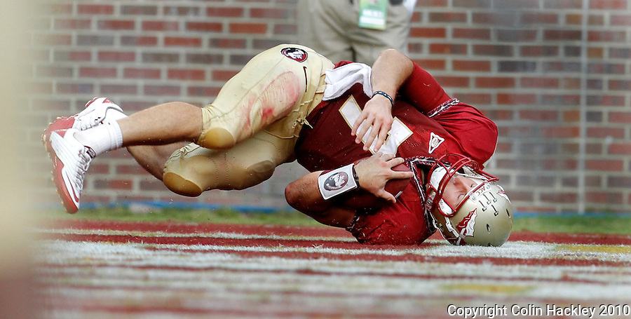 TALLAHASSEE, FL 9/25/10-FSU-WF FB10 CH-Florida State's Christian Ponder tumbles into the end zone for a touchdown against Wake Forest during second half action Saturday at Doak Campbell Stadium in Tallahassee. The Seminoles beat the Demon Deacons 31-0..COLIN HACKLEY PHOTO