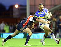 PICTURE BY ALEX WHITEHEAD/SWPIX.COM - Rugby League - Super League Play-Off - Warrington Wolves vs St Helens - The Halliwell Jones Stadium, Warrington, England - 15/09/12 - Warrington's Ryan Atkins is tackled by St Helens' Gary Wheeler.