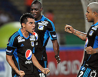 MEDELLÍN -COLOMBIA-16-04-2013. Harrison Otálvaro (i) de Millonarios celebra un gol ante Nacional durante partido de la fecha 11 del la Liga Postobón 2013-1 realizado en el estadio Atanasio Girardot de Medellín./Harrison Otalvaro (l) of Millonarios celebrates a goal against Nacional during match of the 11th date in the 2013-1 Postobon League at Atanasio Girardot stadium in Medellin.  Photo:VizzorImage/Luis Ríos/STR