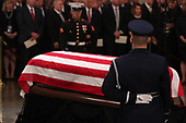 The remains of former President George H.W. Bush lie in state flanked by a U.S. military honor guard during memorial services in the U.S. Capitol Rotunda in Washington, U.S., December 3, 2018. REUTERS/Jonathan Ernst/Pool