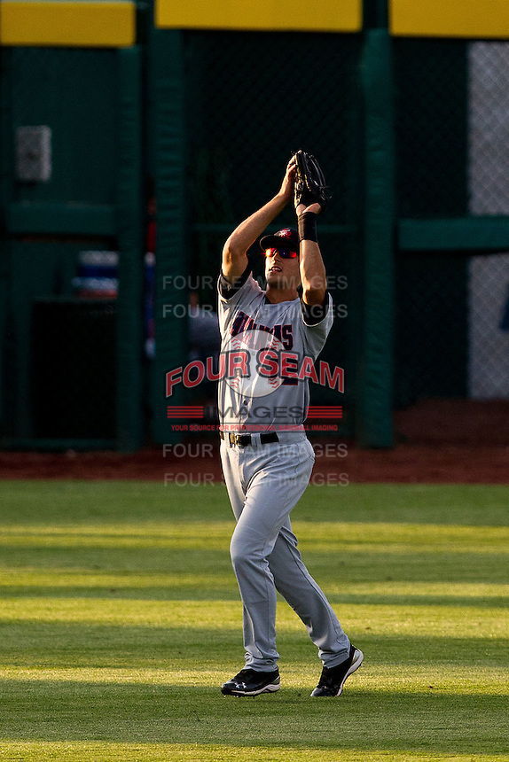 Jimmy Swift (12) of the Arkansas Travelers catches a fly ball to left field during a game against the Springfield Cardinals at Hammons Field on June 12, 2012 in Springfield, Missouri. (David Welker/Four Seam Images).