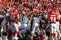 Referee Ed Hochuli signals that the Ravens recover the ball on a fumble by Chiefs quarterback Trent Green during the second quarter at Arrowhead Stadium in Kansas City, Missouri on December 10, 2006.Baltimore won 20-10.