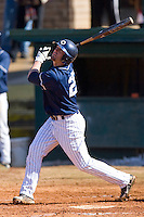 Wade Moore #25 of the Catawba Indians follows through on his swing versus the Shippensburg Red Raiders on February 14, 2010 in Salisbury, North Carolina.  Photo by Brian Westerholt / Four Seam Images