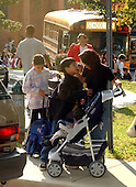 Kensington, MD - October 23, 2002 -- Anguished Mom hugs and kisses her kids outside Oakland Terrace Elementary School in Kensington, MD on 23 October, 2002.<br /> Credit: Ron Sachs / CNP<br /> (RESTRICTION: NO New York or New Jersey Newspapers or newspapers within a 75 mile radius of New York City)