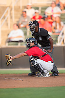 Kannapolis Intimidators catcher Seby Zavala (21) reaches for a pitch as home plate umpire Darrell Roberts looks on during the game against the Hagerstown Suns at Kannapolis Intimidators Stadium on July 4, 2016 in Kannapolis, North Carolina.  The Intimidators defeated the Suns 8-2.  (Brian Westerholt/Four Seam Images)