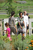 United States First Lady Michelle Obama speaks with with chef Dan Barber as she tours Stone Barns Center Pocantico Hills, New York on Friday, September 24, 2010 with a large group of other First Ladies visiting New York for the United Nations General Assembly. They viewed the mobile chicken coop and herb garden while making a tour of the facilities.  A lunch was prepared with the food from the farm. .Credit: Andrea Renault / Pool via CNP