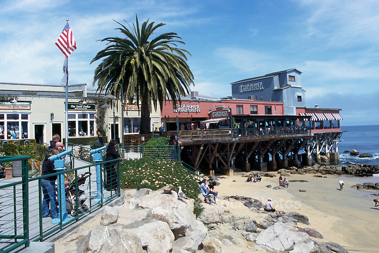 """Shops, Restaurants, and Beach along Monterey Bay at Steinbeck Plaza, along """"Cannery Row"""", in the City of Monterey, California, USA"""