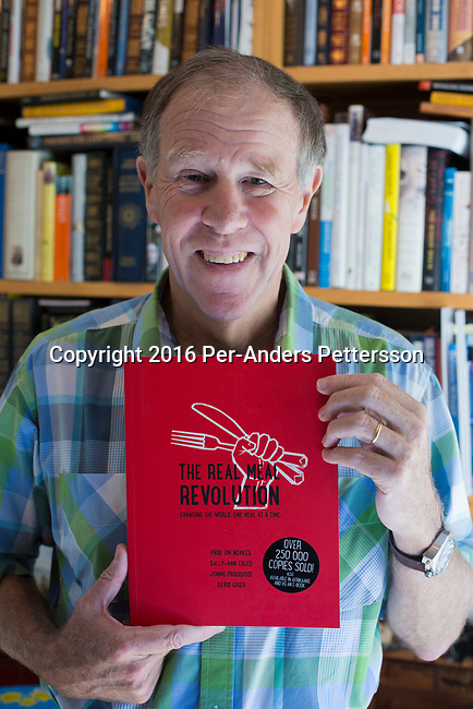 CAPE TOWN, SOUTH AFRICA - AUGUST 10: Tim Noakes,  a South African scientist holds his book The real meal revolution in his home office  on August 10, 2016 in Constantia, outside Cape Town, South Africa.  (Photo by Per-Anders Pettersson/Getty Images)