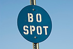 BO Spot blue circle sign along the railroad in the Mojave Desert