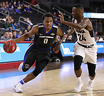 SIOUX FALLS, SD: MARCH 5: Mo Evans #0 of IPFW drives on Tra-Deon Hollins #24 of Omaha during the Summit League Basketball Championship on March 5, 2017 at the Denny Sanford Premier Center in Sioux Falls, SD. (Photo by Dick Carlson/Inertia)