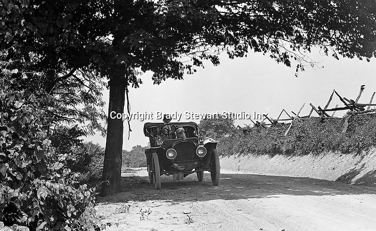 Southwestern Ohio:  Brady Stewarts Aunt is out for a ride with her Bichon - 1906