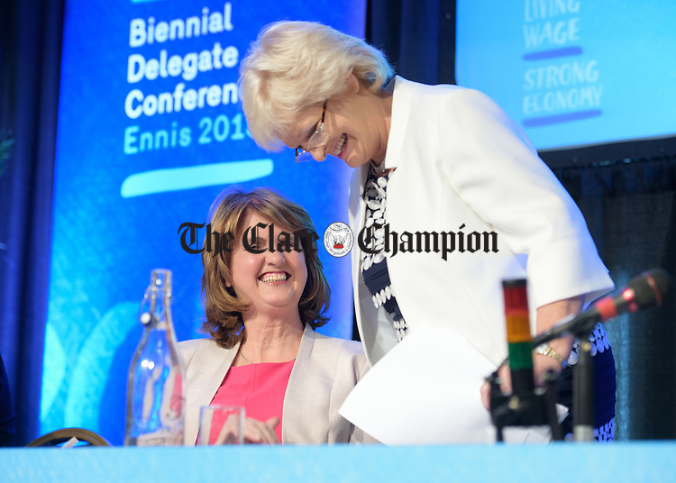 Joan Burton, Tanaiste and Minister for Social Protection shares a joke with Patricia King General Secretary ICTU after she addressed the Irish Congress of Trade Unions' Biennial Delegate Conference in Treacey's West County Hotel. Photograph by John Kelly.