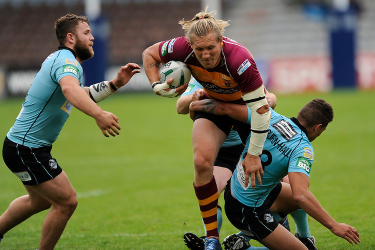 Eorl Crabtree of Huddersfield Giants in action during the Super League match between Huddersfield Giants and London Broncos at The Twickenham Stoop on Saturday 17th August 2013 (Photo by Rob Munro)