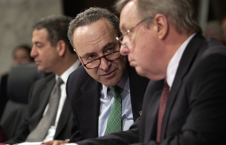 "Sen. Chuck Schumer, D-N.Y., center, has a word with Sen. Dick Durbin, D-Ill., during a Senate Judiciary Committee hearing on NSA spying entitled "" Wartime Executive Power and the NSA's (National Security Agency) Surveillance Authority,""  at which Attorney General Alberto Gonzales testified.  Sen. Russ Feingold, D-Wis., appears at left."