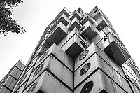 Nakagin Capsule Tower is both a residential and office tower designed by architect Kisho Kurokawa in Tokyo. Built in 1972, the building is an example of Japanese metabolism architecture. Nakajin was the world's first example of capsule architecture built for permanent and practical use. The capsules can be individually removed or replaced. The building still stands but has fallen into disrepair, and several times it has nearly faced demolition and redevelopment.  These days only a few of the capsules are still used as apartments.  Others are used for storage or office space, or abandoned and deteriorating.  Remaining tenants are still trying to save the tower, by requesting donations from around the world to purchase all of the capsules and preserve and renovate the building.