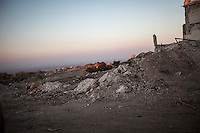 In this Sunday, Sep. 29, 2013 photo, shows the debris of a tank in Telata village, a frontline located at the top of a mountain in the Idlib province countryside of Syria. (AP Photo)