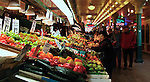 Early morning shoppers at Pike's Place Market in Seattle get the freshest selection of just picked produce.
