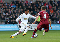 Pictured: Swansea's Jonathan De Guzman takes on Yohan Cabaye<br />