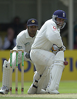 31/05/2002.Sport -Cricket - 2nd NPower Test -Second Day.England vs Sri Lanka.Mark Butcher, pads the ball away [Mandatory Credit Peter Spurrier:Intersport Images]