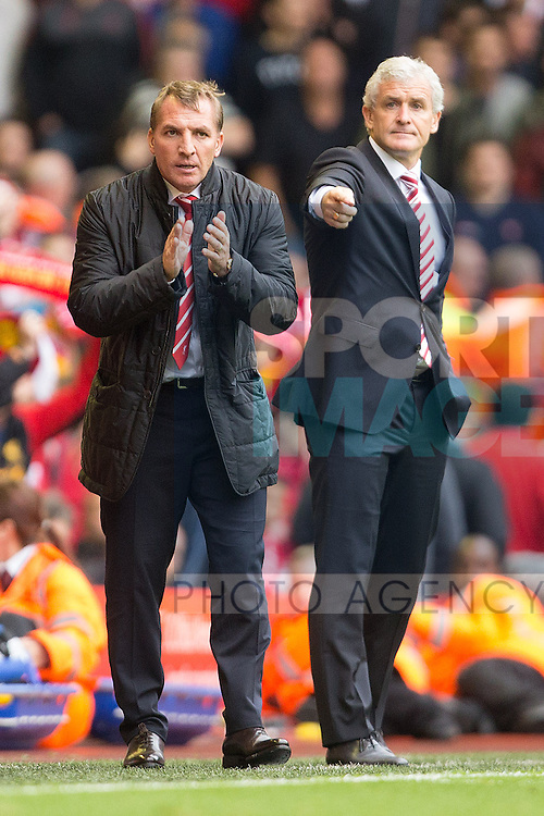 Manager of Liverpool, Brendan Rodgers and Stoke's manager, Mark Hughes - Liverpool vs. Stoke City -  Premier League - Anfield - Liverpool - 17/08/2013 Pic Philip Oldham/Sportimage