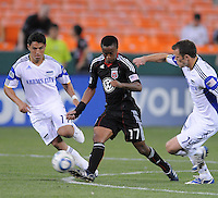 DC United midfielder Thabiso Khumalo (17) makes a pass while cover from the right by Kansas City Wizards midfielder Jack Jewsbury (14) and left midfielder Ryan Smith (11).  DC United defeated The Kansas City Wizards  2-0 at RFK Stadium, Wednesday  May 5, 2010.