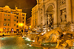 The Trevi Fountain in Rome, Italy, remains impressive at night, when it is illuminated from within and by streetlights surrounding it and the nearby piazza.